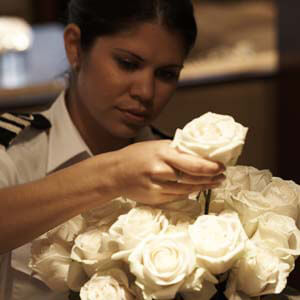 Yacht 2nd Stewardess arranging white roses