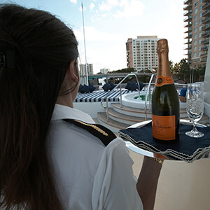 Yacht Butler serving champagne